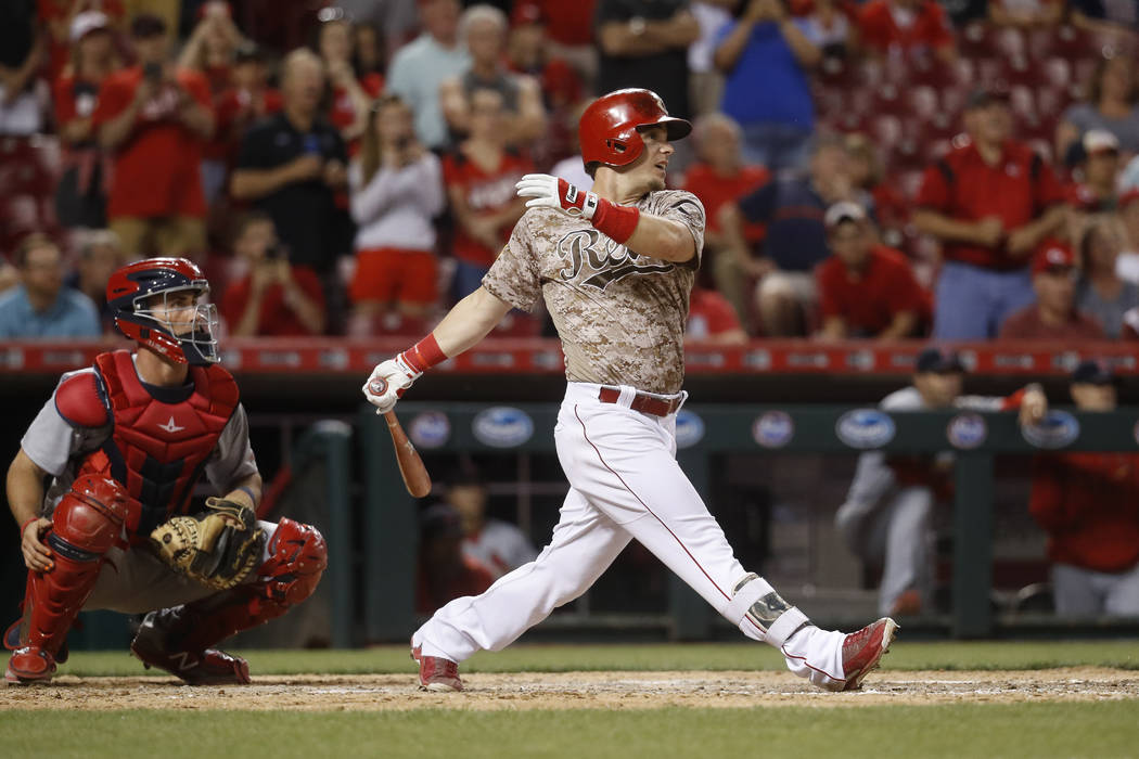 Cincinnati Reds' Scooter Gennett hits a two-run home run and his fourth overall in the eighth inning of a baseball game against the St. Louis Cardinals, Tuesday, June 6, 2017, in Cincinnati. The R ...