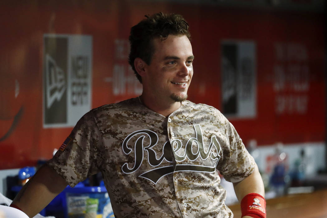 Cincinnati Reds' Scooter Gennett smiles in the dugout during the seventh inning of a baseball game against the St. Louis Cardinals, Tuesday, June 6, 2017, in Cincinnati. The Reds won 13-1. (AP Pho ...