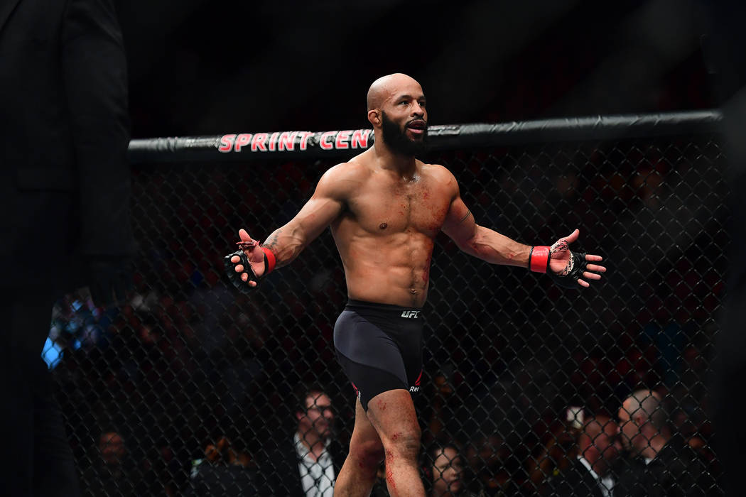 2Apr 15, 2017; Kansas City, MO, USA; Demetrious Johnson (red) celebrates following the win over and Wilson Reis (not pictured) during UFC Fight Night at Sprint Center. Mandatory Credit: Ron Chenoy ...