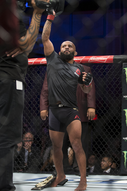 Demetrious Johnson raises his arm in victory against Timothy Elliot in The Ultimate Fighter 24 Finale flyweight title bout at the Palms hotel-casino Pearl Theater on Saturday, Dec. 3, 2016, in Las ...