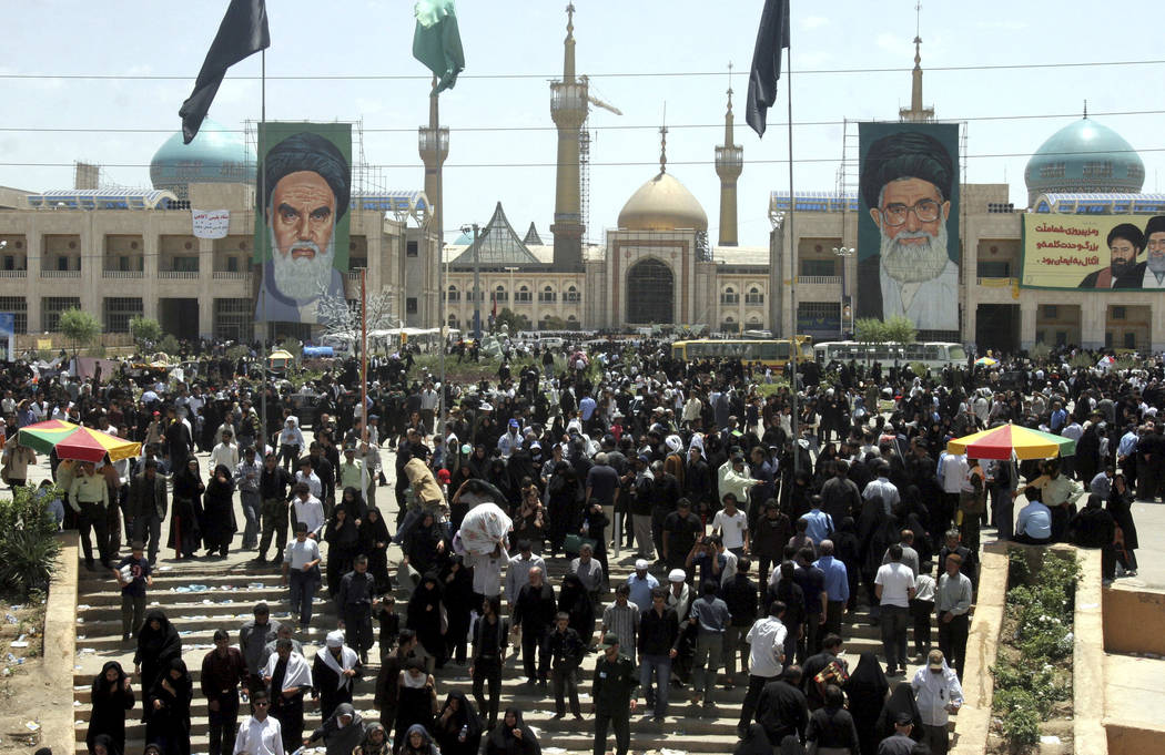 This June 4, 2007, photo shows Iranians in Tehran attending ceremonies on the 18th anniversary of the death of Iran's late leader Ayatollah Ruhollah Khomeini, outside his shrine. English-language  ...