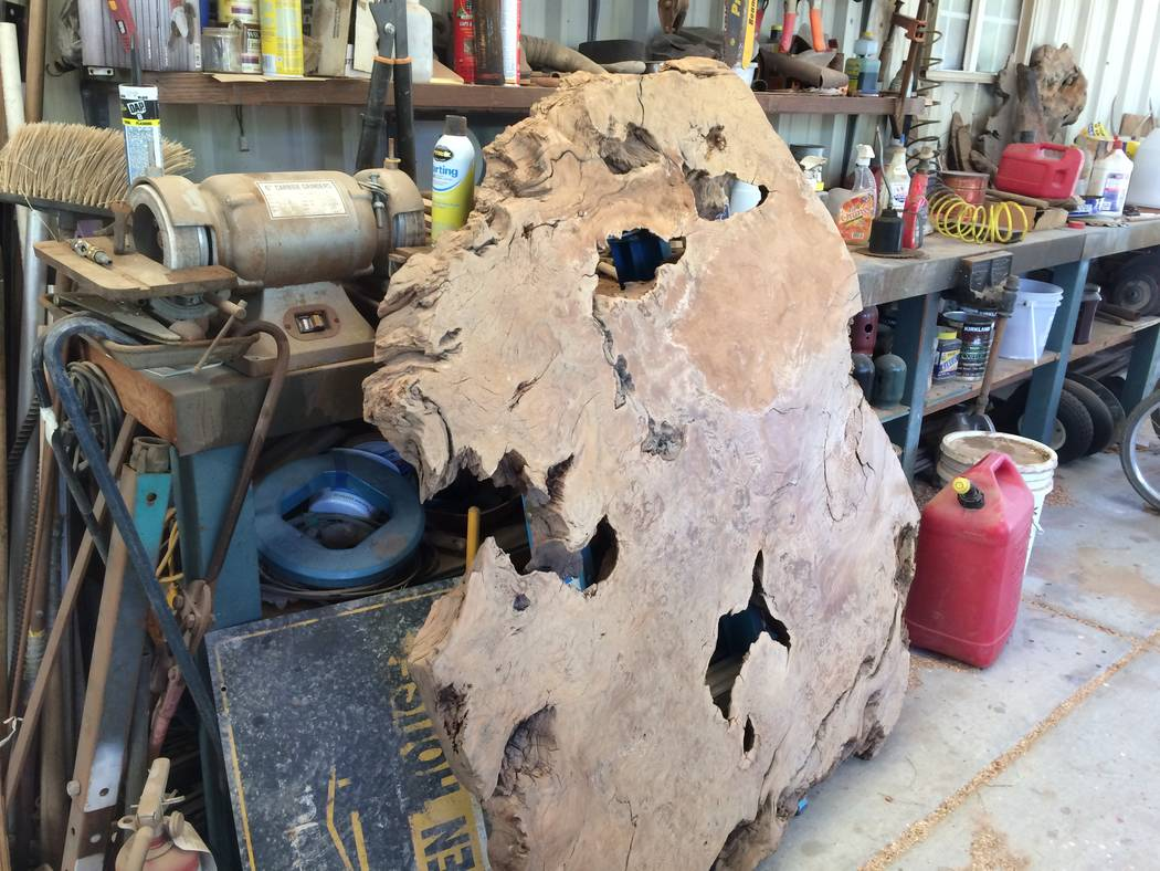 A slice of a tree stump,seen April 2017,  sits waiting to be made into something like a table. Kyle Stinnett likes to let a piece of wood tell him what it should become. (JAN HOGAN/View)