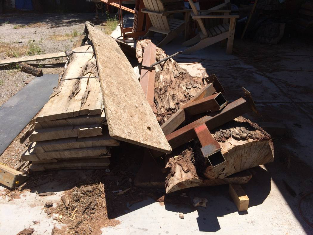A stack of discarded lumber sits in Kyle Stinnett's back yard April 2017. Sometimes the wood tells him into what it's supposed to be made. He has a pile of gnarled stumps and old lumber in his b ...