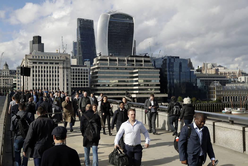 Commuters walk across London Bridge, with new security barriers, after work in London, Tuesday, June 6, 2017. (Matt Dunham/AP)