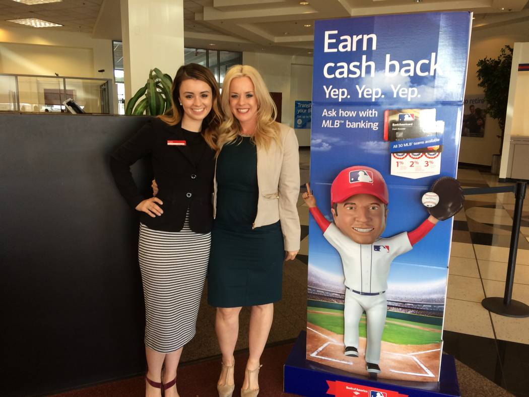 Kayla Beel, left,  pauses with her mother Valarie at a Bank of America branch March 30, 2017. Kayla decided to follow in her mother's footsteps after seeing how she rose through ranks from her fir ...