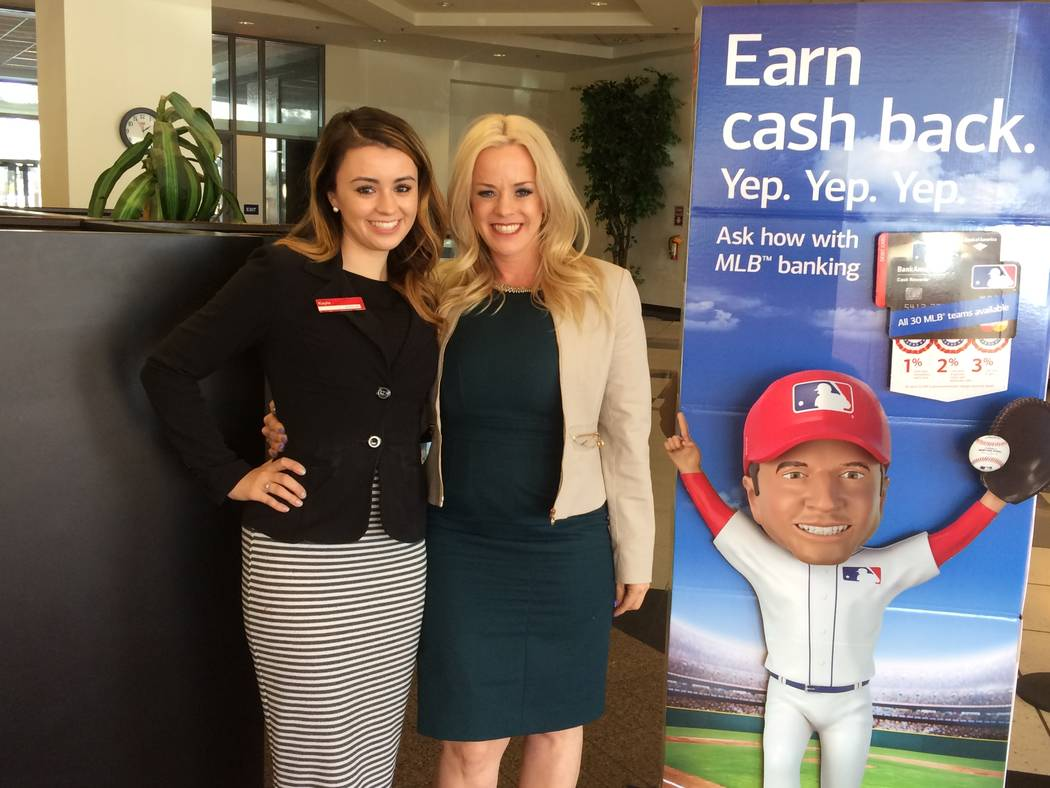 Kayla Beel, left, pauses with her mother Valarie at a Bank of America branch March 30, 2017. Kayla decided to follow in her mother's footsteps after seeing how she rose through ranks from her firs ...
