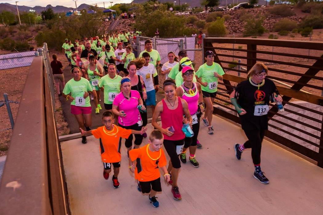 Runners compete in the 2016 Glow Worm 5K Fun Run at Equestrian Park South and Trailhead. (City of Henderson)