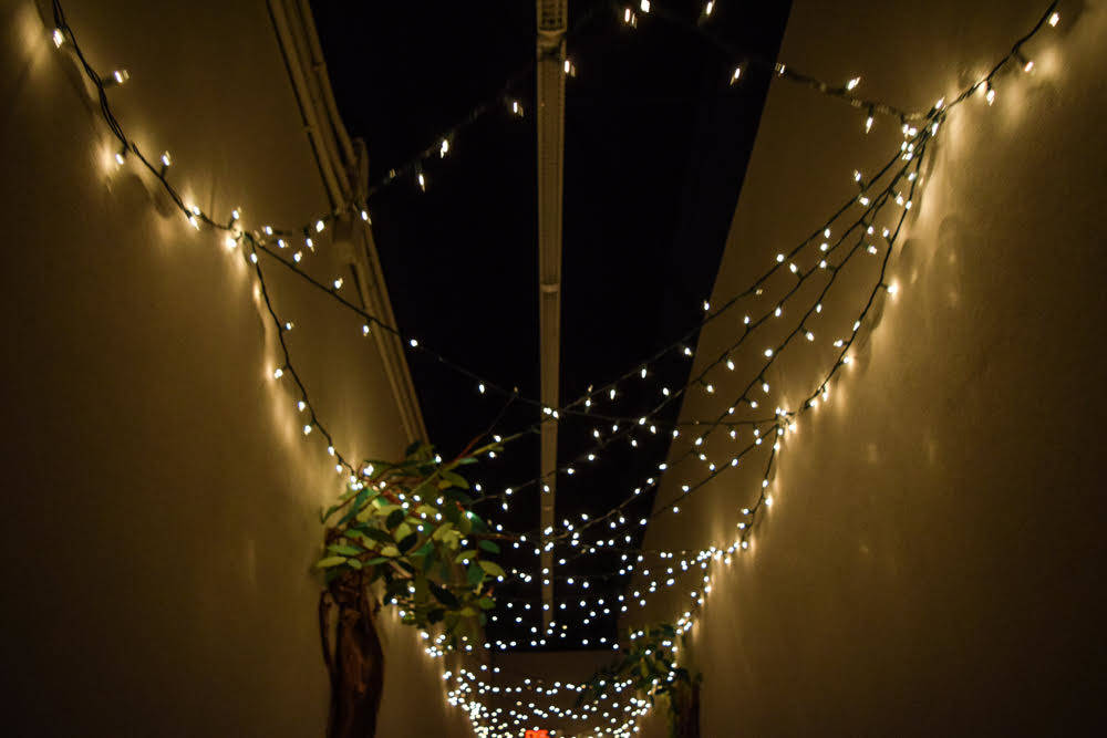 "Blake set up lights to dangle below the ceiling of the ""long hallway,"" that leads to theatre so parents entering the performance could experience the ambiance. (Alex Meyer/View) @alxmey"