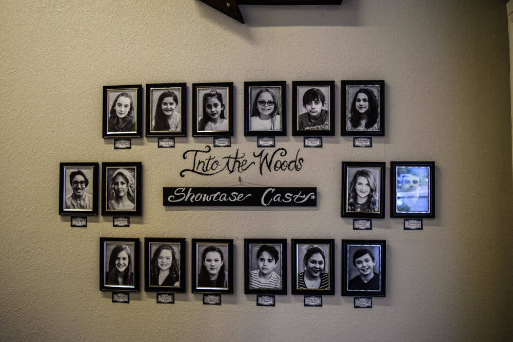 Each cast of the company's latest large-scale production is displayed on the hallway leading to the theatre so other students can feel inspired. (Alex Meyer/View) @alxmey