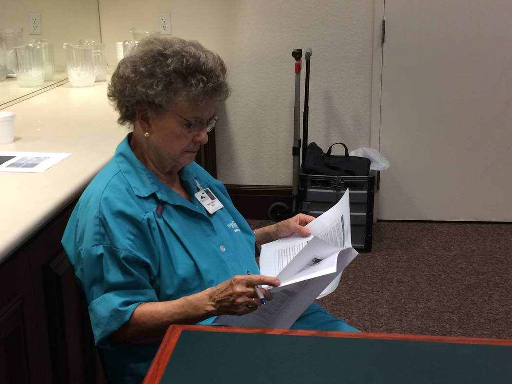 Shirley Calderon, volunteer at Summerlin Hospital, reads literature on added sugars May 11, 2017, at a lecture given by Monica Serna, clinical nutrition manager at Desert Springs Hospital. (JAN HO ...