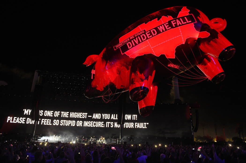 An inflatable pig flies above the crowd during Roger Waters' closing set on day 3 of the 2016 Desert Trip music festival at Empire Polo Field on Sunday, Oct. 9, 2016, in Indio, Calif. (Photo by Ch ...