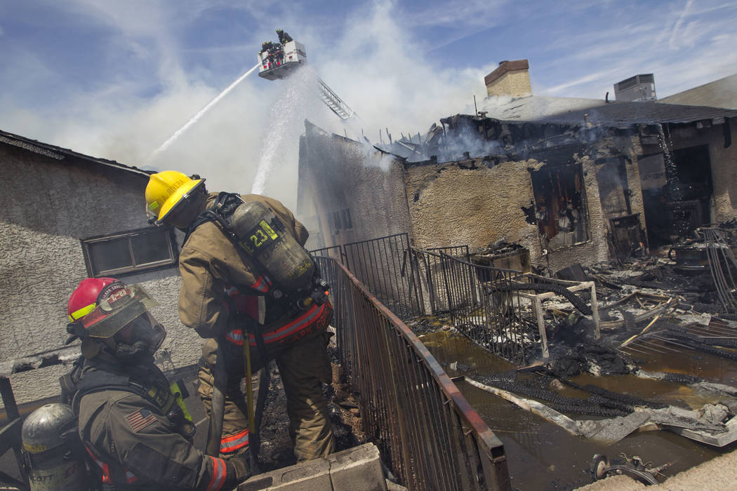 Clark County firefighters work to extinguish a two-house fire in the 3600 block of Three Bars Court in northeast Las Vegas on Wednesday, June 7, 2017. (Richard Brian Las Vegas Review-Journal) @veg ...
