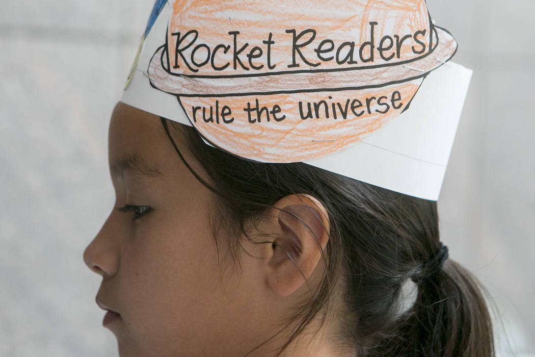 Valeria Delrio, 8, wears a hat she decorated in part of Reading Rangers program at Boulevard Mall on Saturday, June 10, 2017 in Las Vegas. To promote summer reading, the program gives kids the opp ...