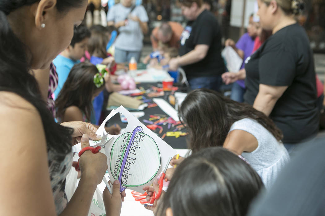 Parents and kids work on decorating capes and hats in part of Reading Rangers program at Boulevard Mall on Saturday, June 10, 2017 in Las Vegas. To promote summer reading, the program gives kids t ...