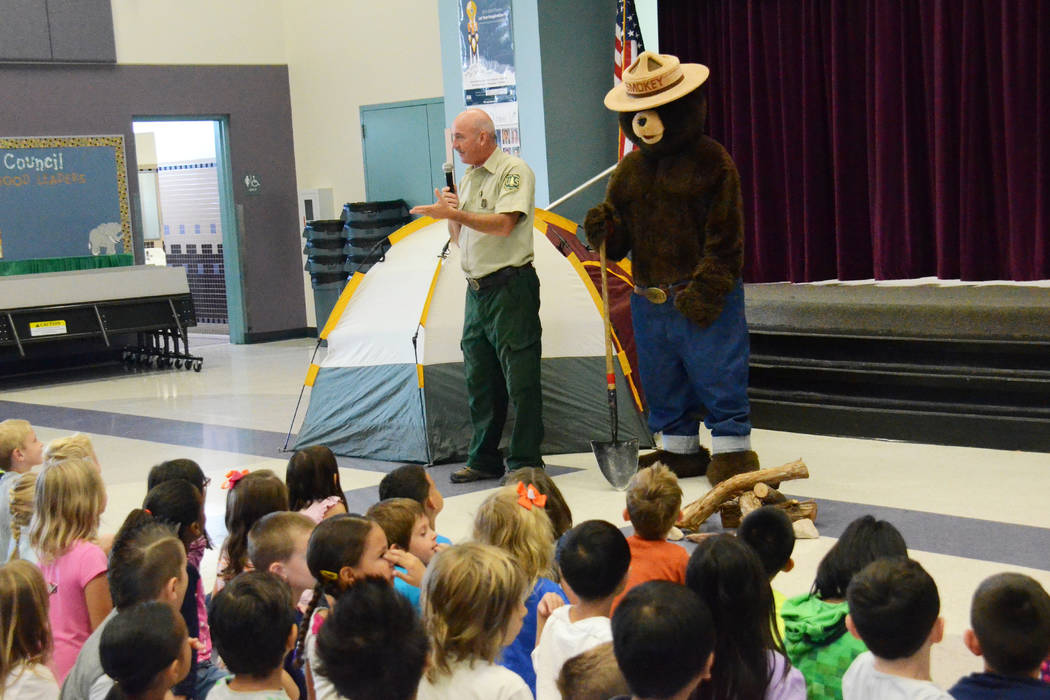 Fire Prevention Technician Ray Johnson and his pal Smokey speak to kids at a local elementary school in 2015. Johnson has received a prestigious national award for his work educating the public ab ...