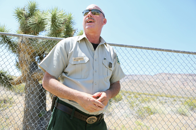 Ray Johnson, a spokesman for the U.S. Forest Service and a prevention patrol officer, speaks about what causes wildfires during an open house at Bureau of Land Management's Red Rock Fire Station F ...