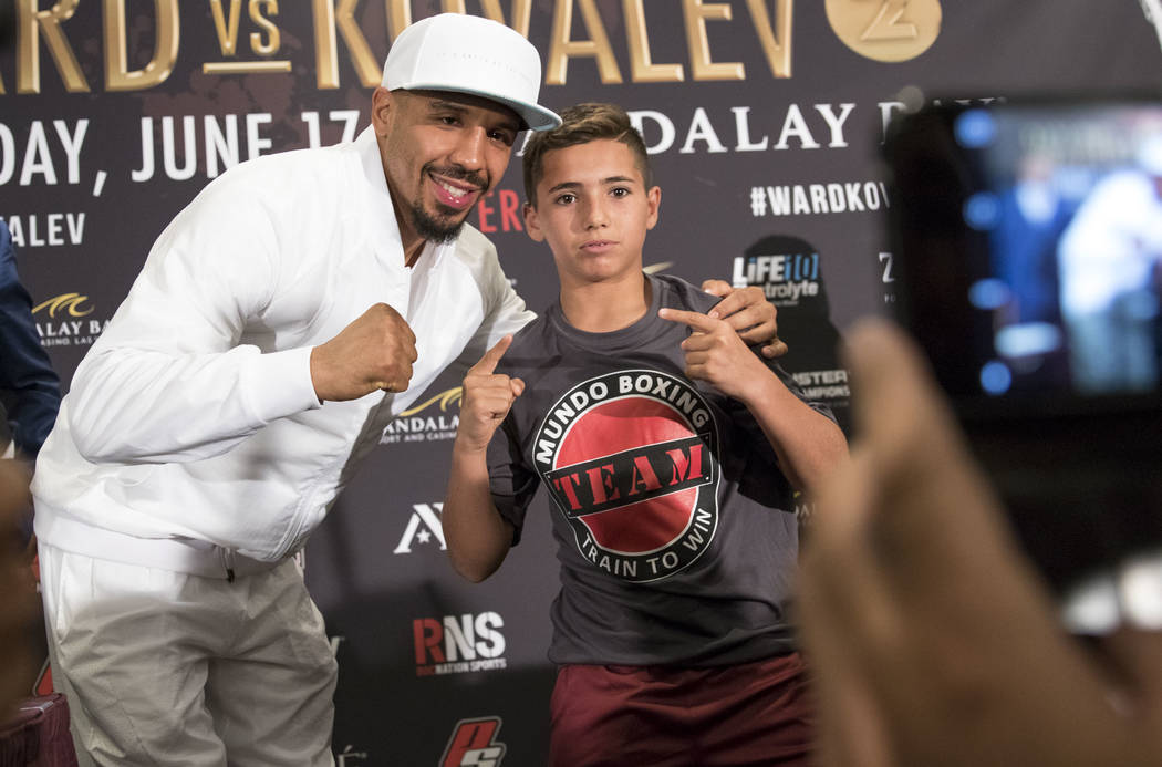Boxer Andre Ward poses with youngster following a news conference at the Mandalay Bay Events Center on Thursday, June 15, 2017. Richard Brian Las Vegas Review-Journal @vegasphotograph