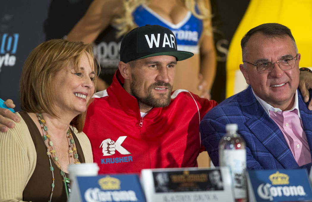 Russian boxer Sergey Kovalev is flanked by Main Events CEO Kathy Duva and his manager Egis Klimas during a news conference at the Mandalay Bay Events Center on Thursday, June 15, 2017. Andre Ward  ...