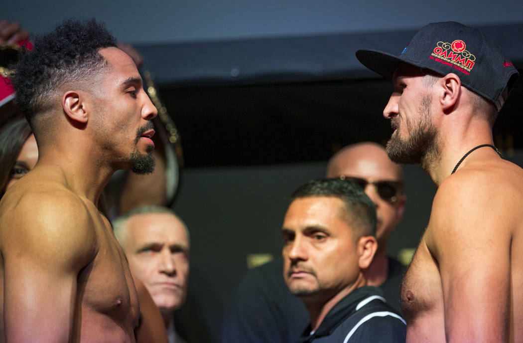 Boxers Andre Ward, left, and Sergey Kovalev face off during a weigh-in event at the Mandalay Bay Events Center in Las Vegas on Friday, June 16, 2017. The two boxers are set to fight in a light hea ...