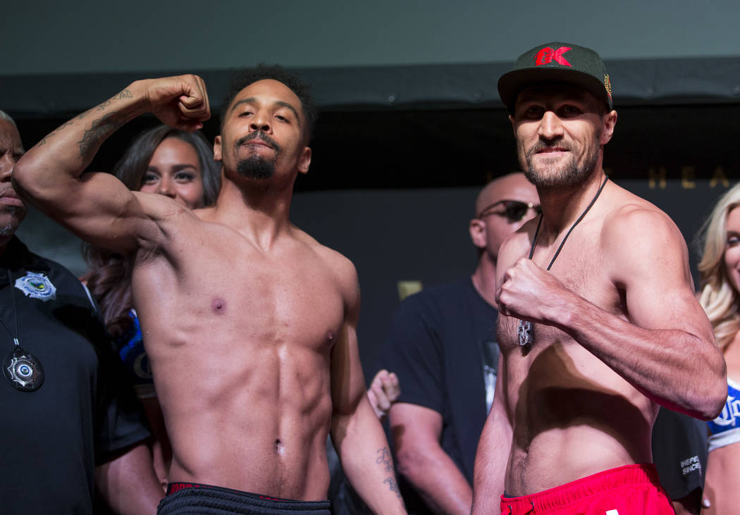 Boxers Andre Ward, left, and Sergey Kovalev acknowledge the crowd during a weigh-in event at the Mandalay Bay Events Center in Las Vegas on Friday, June 16, 2017. The two boxers are set to fight i ...