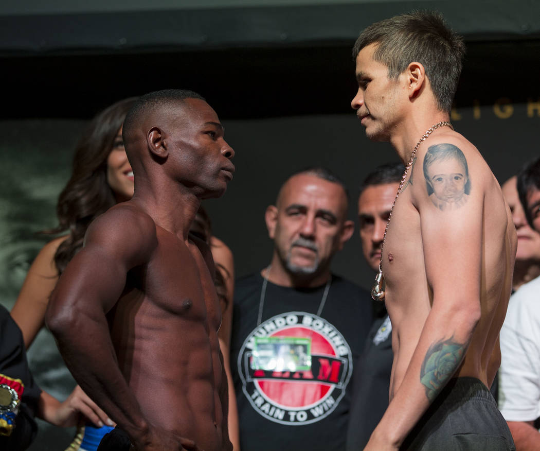 Guillermo Rigondeaux, left, and Moises Flores face off during a weigh-in event at the Mandalay Bay Events Center in Las Vegas on Friday, June 16, 2017. The two are scheduled to fight in a super ba ...