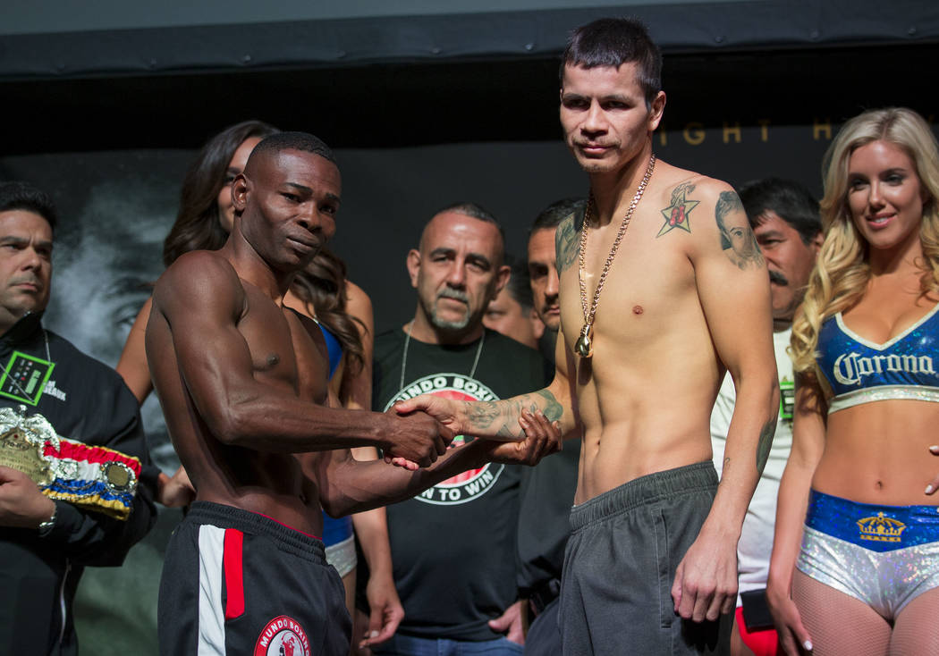 Guillermo Rigondeaux, left, and Moises Flores during a weigh-in event at the Mandalay Bay Events Center in Las Vegas on Friday, June 16, 2017. The two are scheduled to fight in a super bantamweigh ...