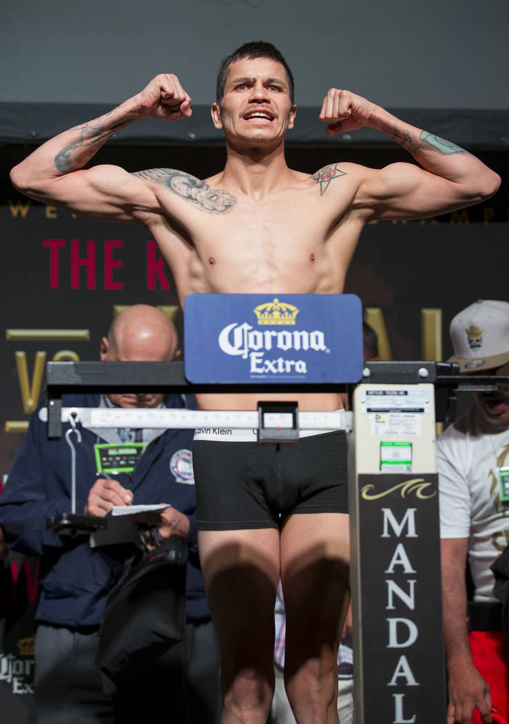 Moises Flores on the scale during a weigh-in event at the Mandalay Bay Events Center in Las Vegas on Friday, June 16, 2017. Flores is scheduled to fight Guillermo Rigondeaux in a super bantamweigh ...