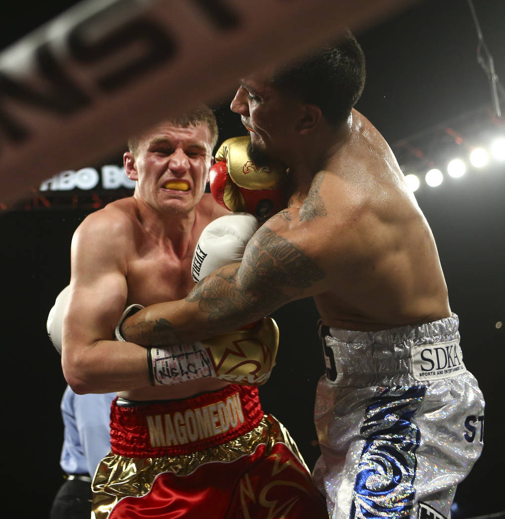 Arif Magomedov, left, and Luis Arias fight during their middleweight fight at the Mandalay Bay Events Center in Las Vegas on Saturday, June 17, 2017. Arias won via technical knockout. Chase Steven ...
