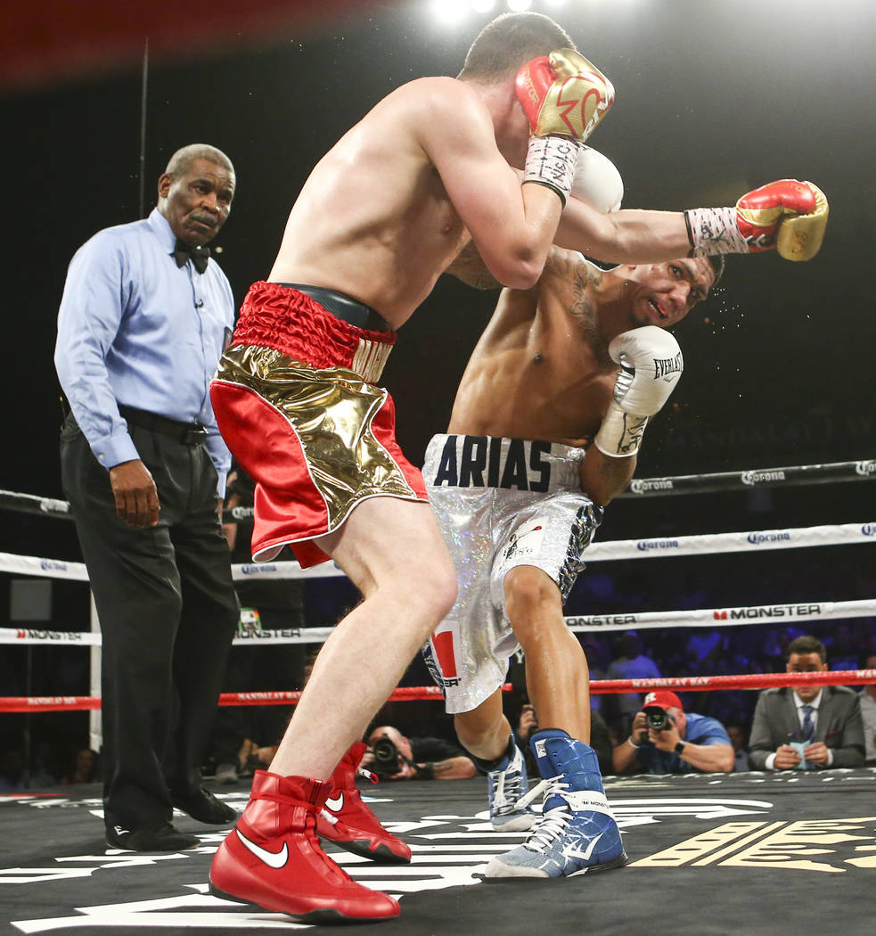 Arif Magomedov, left, fights Luis Arias during their middleweight fight at the Mandalay Bay Events Center in Las Vegas on Saturday, June 17, 2017. Arias won via technical knockout. Chase Stevens L ...
