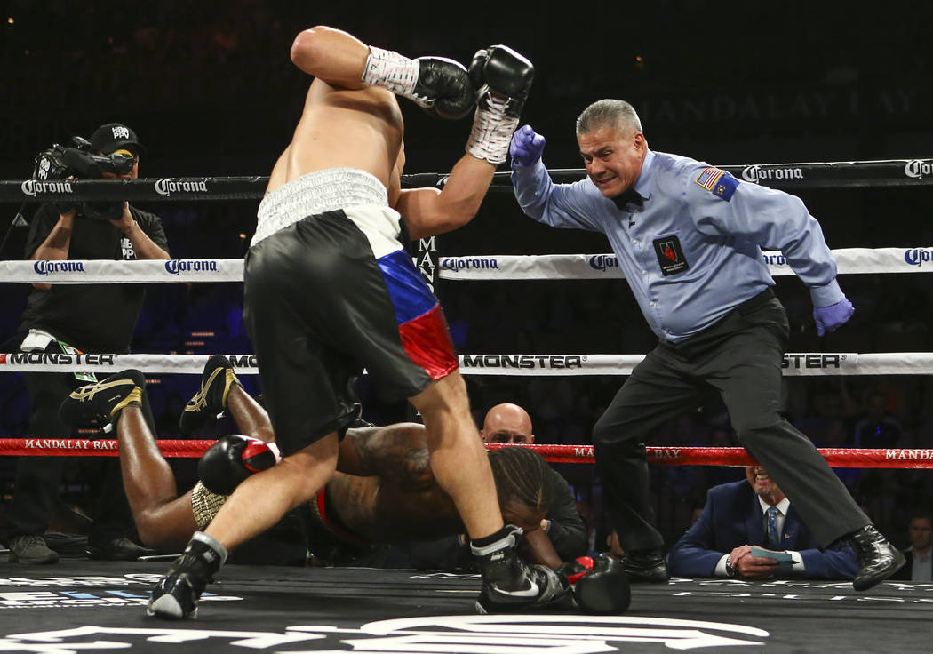 Dmitry Bivol knocks down Cedric Agnew during their light heavyweight fight at the Mandalay Bay Events Center in Las Vegas on Saturday, June 17, 2017. Bivol won via technical knockout. Chase Steven ...