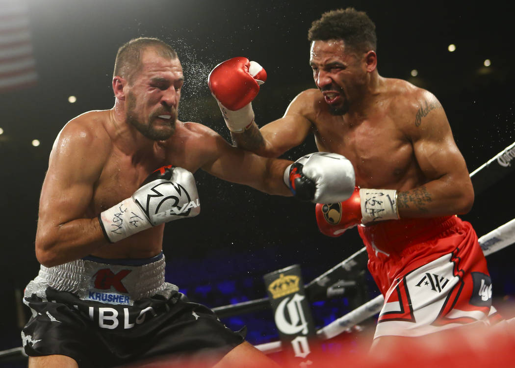 Sergey Kovalev, left, takes a hit from Andre Ward during their light heavyweight championship fight at the Mandalay Bay Events Center in Las Vegas on Saturday, June 17, 2017. Ward won via technica ...