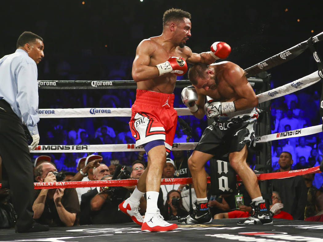 Andre Ward, left, delivers the final blows before defeating Sergey Kovalev in the 8th round via technical knockout during their light heavyweight championship fight at the Mandalay Bay Events Cent ...