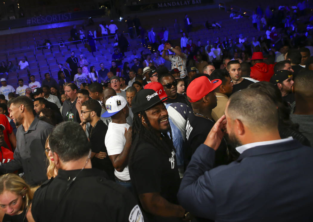 Oakland Raiders' Marshawn Lynch, center, in the crowd after Andre Ward's technical knockout over Sergey Kovalev in the 8th round at the Mandalay Bay Events Center in Las Vegas on Saturday, June 17 ...