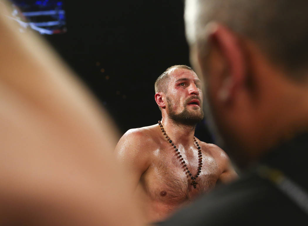 Sergey Kovalev watches a replay video after being defeated by Andre Ward in the 8th round via technical knockout in their light heavyweight championship fight at the Mandalay Bay Events Center in  ...