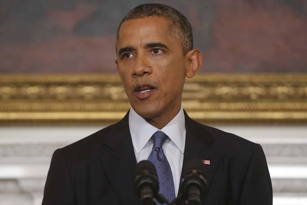 President Barack Obama speaks in the State Dining Room at the White House in Washington, Thursday, Aug. 7, 2014. (AP Photo/Charles Dharapak)