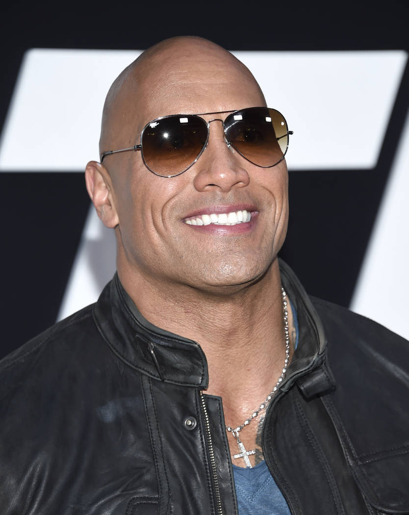 """Dwayne Johnson attends the world premiere of Universal Pictures' """"The Fate of the Furious"""" at Radio City Music Hall on Saturday, April 8, 2017, in New York. (Photo by Evan Agosti ..."""
