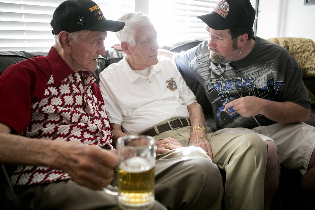 World War II veteran Allen Panowich, left, chats with his friends during a BBQ party to celebrate his 101st birthday on Wednesday, June 7, 2017, in Las Vegas.  Bridget Bennett Las Vegas Review-Jou ...
