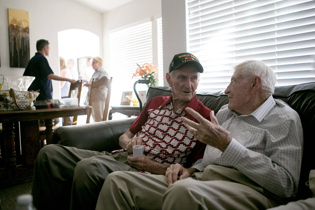 World War II veterans Allen Panowich, left, and Ed Hall chat during a BBQ party to celebrate Panowich's 101st birthday on Wednesday, June 7, 2017, in Las Vegas.  Bridget Bennett Las Vegas Review-J ...