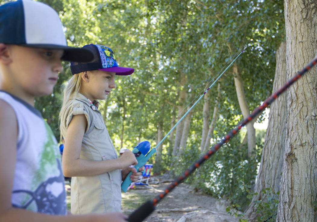Eight-year-olds Gavin Phillips and Emma Polenske wait for fish to bite during a fishing derby held by the Las Vegas City Council at Floyd Lamb Park at Tule Springs in northwest Las Vegas on Saturd ...
