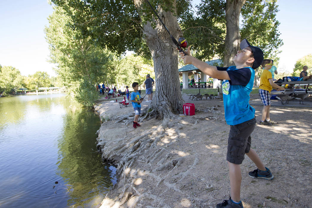 Ten-year-old Jackson Thunell of Las Vegas casts his reel during a fishing derby held by the Las Vegas City Council at Floyd Lamb Park at Tule Springs in northwest Las Vegas on Saturday, June 10, 2 ...