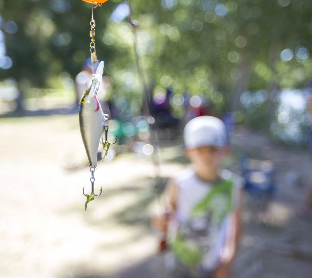 Eight-year-old Gavin Phillips of Las Vegas shows off his fishing lure during a fishing derby held by the Las Vegas City Council at Floyd Lamb Park at Tule Springs in northwest Las Vegas on Saturda ...