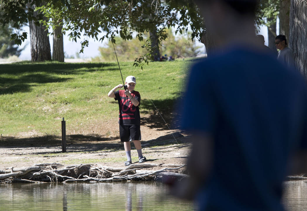 Youngsters participate in a fishing derby held by the Las Vegas City Council at Floyd Lamb Park at Tule Springs in northwest Las Vegas on Saturday, June 10, 2017. Richard Brian Las Vegas Review-Jo ...