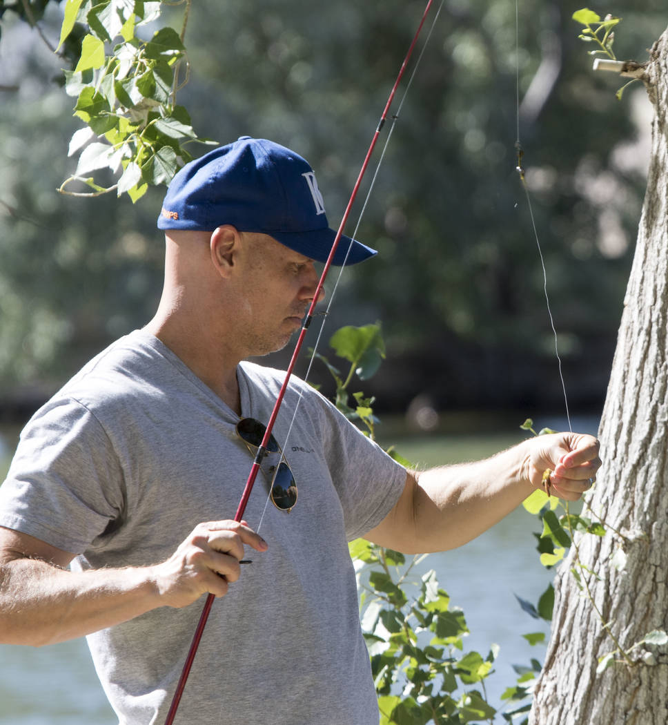 Las Vegas resident Jason Parochniak prepares his fishing pole during a fishing derby held by the Las Vegas City Council at Floyd Lamb Park at Tule Springs in northwest Las Vegas on Saturday, June  ...