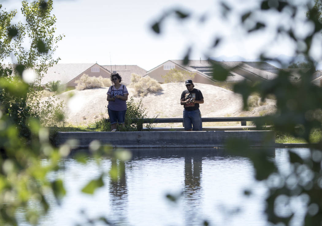 People wait for fish to bite during a fishing derby held by the Las Vegas City Council at Floyd Lamb Park at Tule Springs in northwest Las Vegas on Saturday, June 10, 2017. Richard Brian Las Vegas ...