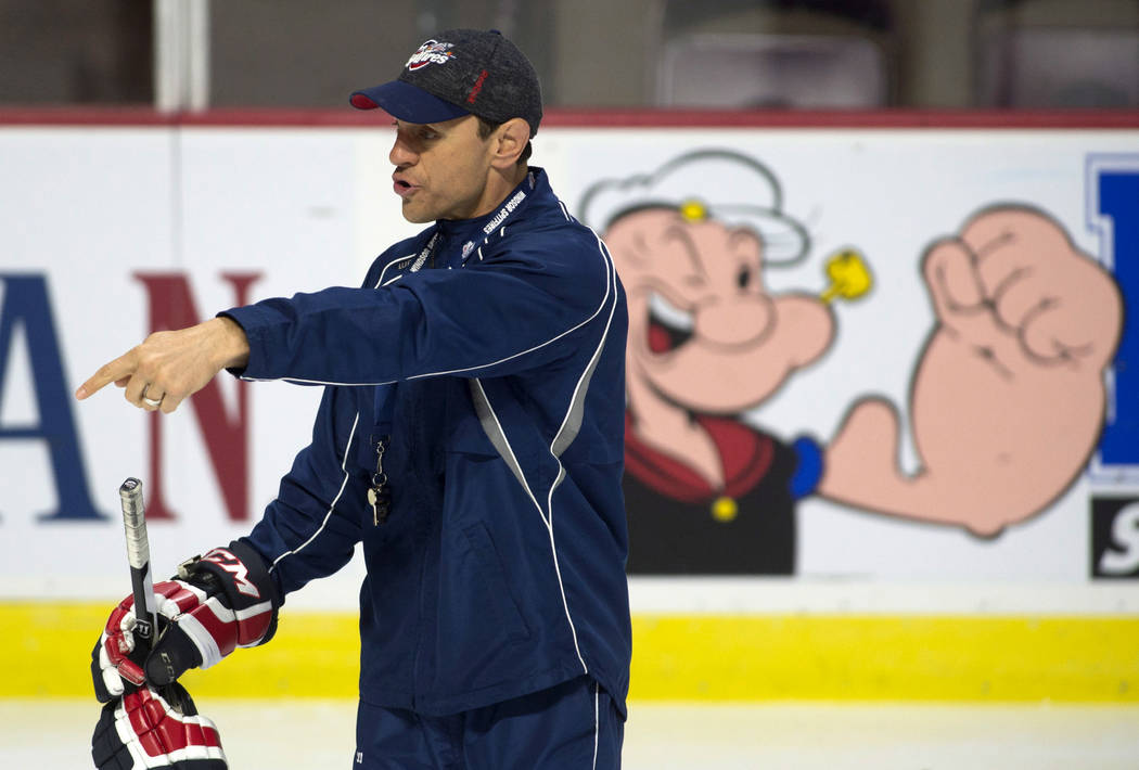 Windsor Spitfires head coach Rocky Thompson gives direction to players during practice Saturday, May 27, 2017, in Windsor, Ontario. (Adrian Wyld/The Canadian Press via AP)