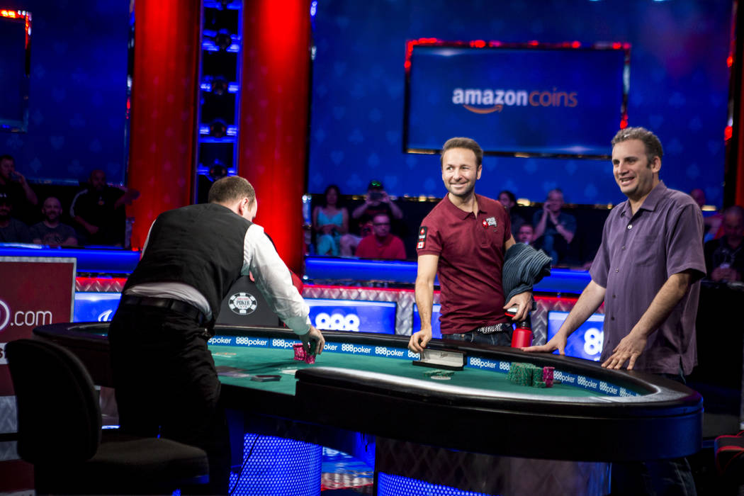 Abe Mosseri, right, celebrates after ousting Daniel Negreanu and winning the $10,000 Omaha Hi-Lo 8 or Better at the World Series of Poker on Wednesday, June 7, 2017.  Patrick Connolly Las Vegas Re ...