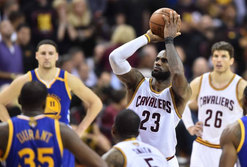Cleveland Cavaliers forward LeBron James (23) shoots a free throw during the fourth quarter against the Golden State Warriors in game three of the 2017 NBA Finals at Quicken Loans Arena. (Ken Blaz ...