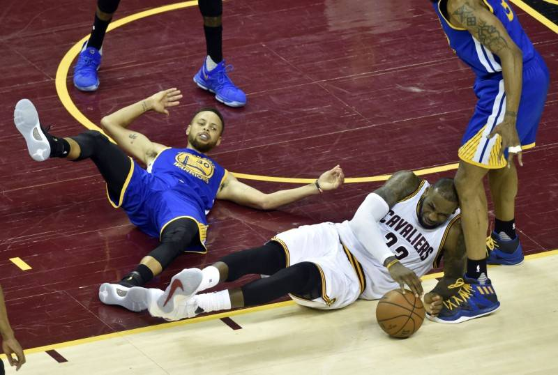 Cleveland Cavaliers forward LeBron James (23) falls down while driving to the basket against Golden State Warriors guard Stephen Curry (30) during the fourth quarter in game three of the 2017 NBA  ...