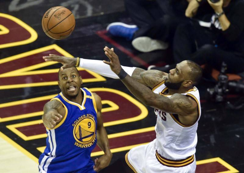 Cleveland Cavaliers forward LeBron James (23) passes as Golden State Warriors forward Andre Iguodala (9) defends during the fourth quarter in game three of the 2017 NBA Finals at Quicken Loans Are ...