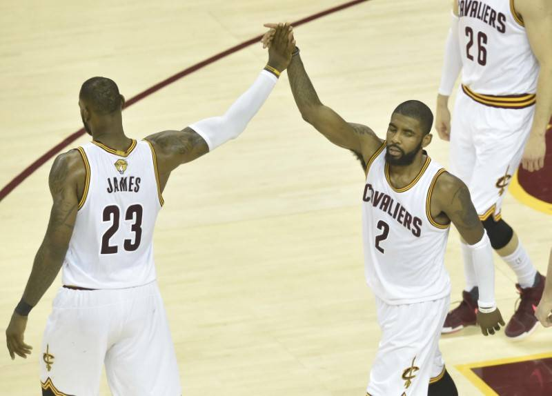 Cleveland Cavaliers forward LeBron James (23) and guard Kyrie Irving (2) high-five during the fourth quarter against the Golden State Warriors in game three of the 2017 NBA Finals at Quicken Loans ...